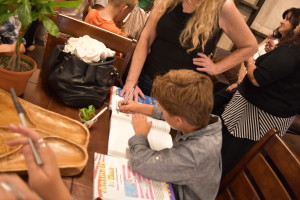 Jackson signing books along with the other kids.