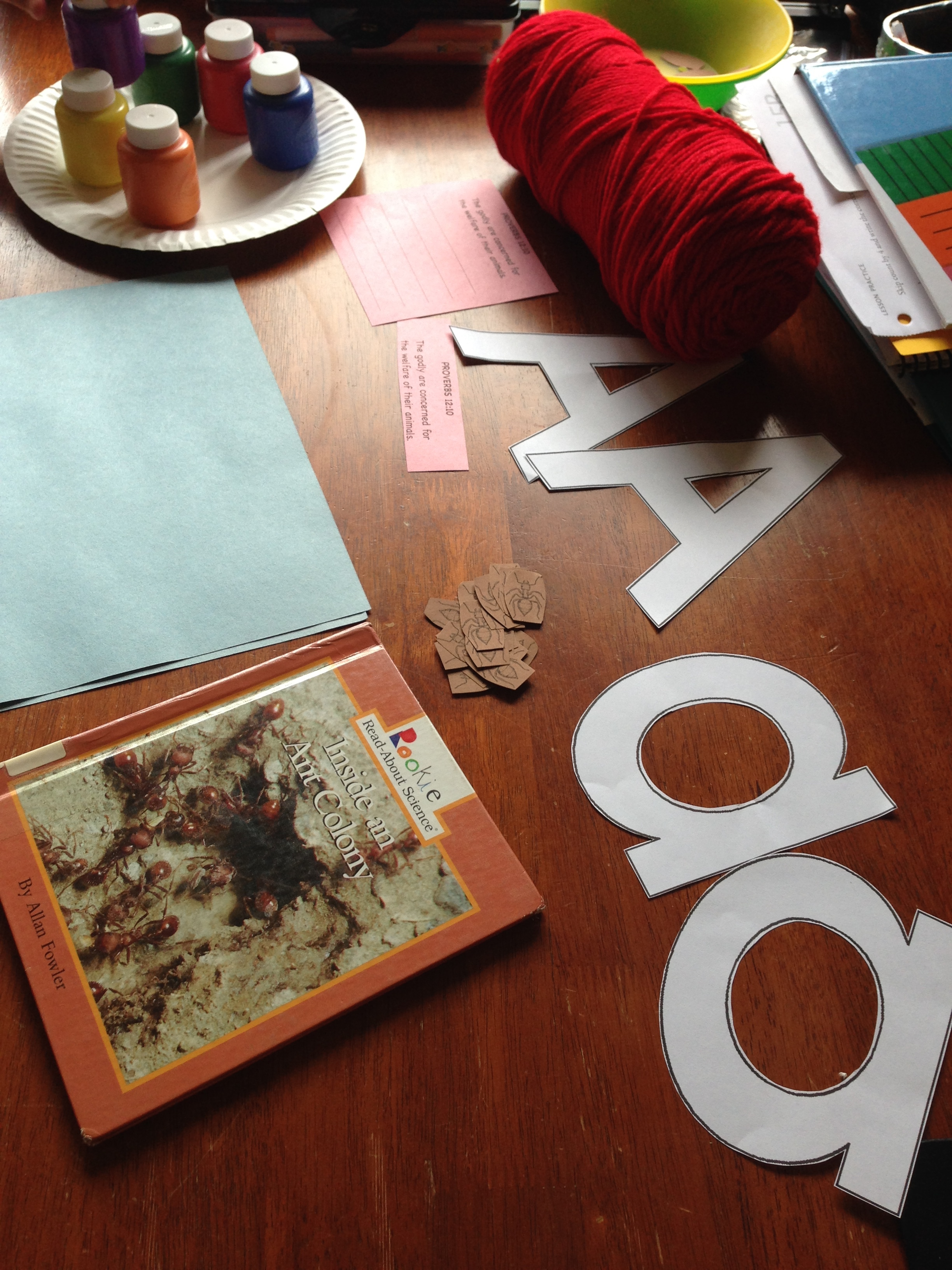 A few minutes cutting the a's, and making the ant book, yarn, paint, and construction paper handy helped prepare for a smooth day.