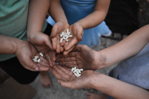 Dirt and seed in hand = smiling kids!
