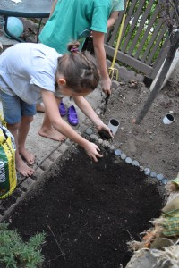 Adding more soil by hand
